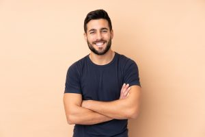 man happy to show off his healthy smile